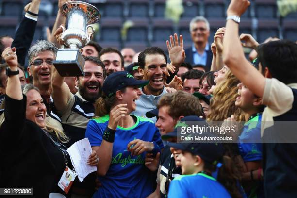 Rafael Nadal of Spain celebrates with the trophy and ground staff after victory in his Mens Final match against Alexander Zverev of Germany during...