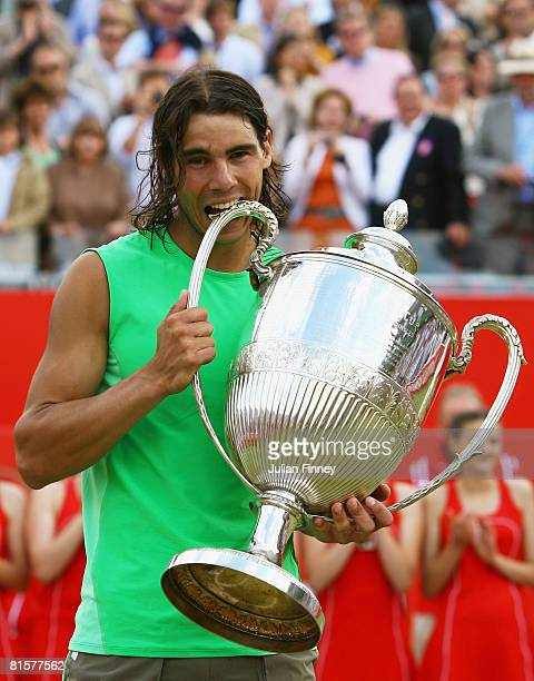 Rafael Nadal of Spain celebrates with the trophy following his victory during the Men's Singles Final match against Novak Djokovic of Serbia on Day 7...