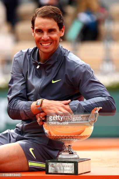 Rafael Nadal of Spain celebrates with the trophy following the mens singles final against Dominic Thiem of Austria during Day fifteen of the 2019...