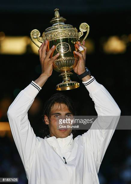 Rafael Nadal of Spain celebrates with the trophy winning the Championship during the men's singles Final match against Roger Federer of Switzerland...