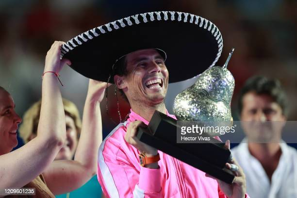 Rafael Nadal of Spain celebrates with the winner's trophy after defeating Taylor Fritz of the United States during Day 6 of the ATP Mexican Open at...