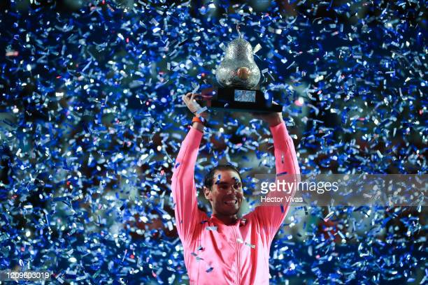 Rafael Nadal of Spain celebrates with the winner's trophy after winning the final singles match against Taylor Fritz of the United States during Day...