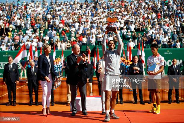 Rafael Nadal of Spain celebrates with the winners trophy after winning the Monte Carlo Rolex Masters against Kei Nishikori of Japan during day eight...