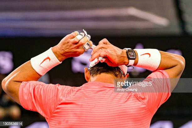 Rafael Nadal of Spain changes bandana between sets during his Men's Singles Quarterfinals match against Stefanos Tsitsipas of Greece during day 10 of...