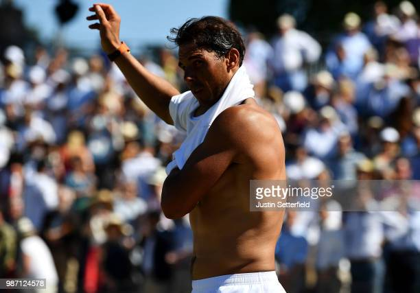Rafael Nadal of Spain changes his shirt against Lucas Pouille of France during the Aspall Tennis Classic at Hurlingham on June 29 2018 in London...