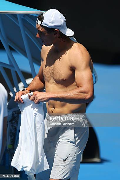 Rafael Nadal of Spain changes shirts during a practice session ahead of the 2016 Australian Open at Melbourne Park on January 13 2016 in Melbourne...