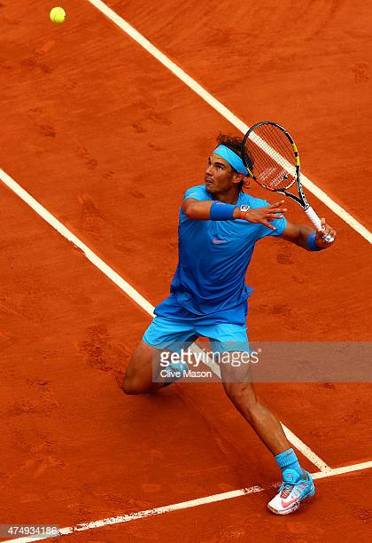 Rafael Nadal of Spain chases the ball during his Men's Singles match against Nicolas Almagro of Spain on day five of the 2015 French Open at Roland...