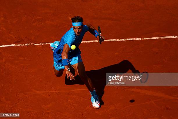 Rafael Nadal of Spain chases the ball in his Men's quarter final match against Novak Djokovic of Serbia on day eleven of the 2015 French Open at...