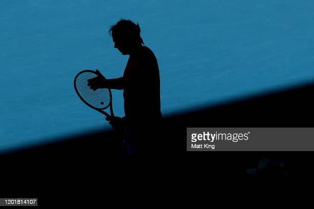 Rafael Nadal of Spain checks his racquet in between points during his Men's Singles third round match against Pablo Carreno Busta of Spain on day six...