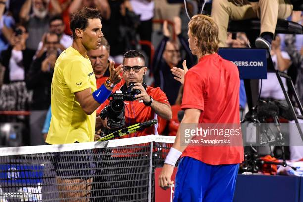 Rafael Nadal of Spain congratulates Denis Shapovalov of Canada for his victory during day seven of the Rogers Cup presented by National Bank at...