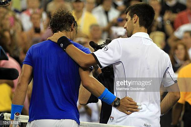 Rafael Nadal of Spain congratulates Novak Djokovic of Serbia after Djokovic won the Men's Final on Day Fifteen of the 2011 US Open at the USTA Billie...