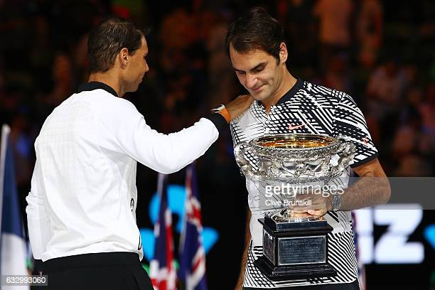Rafael Nadal of Spain congratulates Roger Federer of Switzerland on winning their Men's Final match on day 14 of the 2017 Australian Open at...