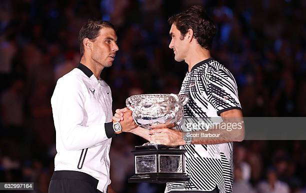 Rafael Nadal of Spain congratulates Roger Federer of Switzerland on winning their Men's Final as Roger Federer holds the Norman Brookes Challenge Cup...