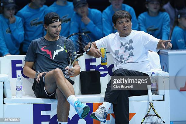 Rafael Nadal of Spain discusses tatics with his coach Toni Nadal during a practice session prior to the start of ATP World Tour Finals Tennis at O2...