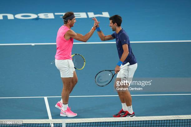 Rafael Nadal of Spain embraces Novak Djokovic of Serbia during the Rally for Relief Bushfire Appeal event at Rod Laver Arena on January 15 2020 in...