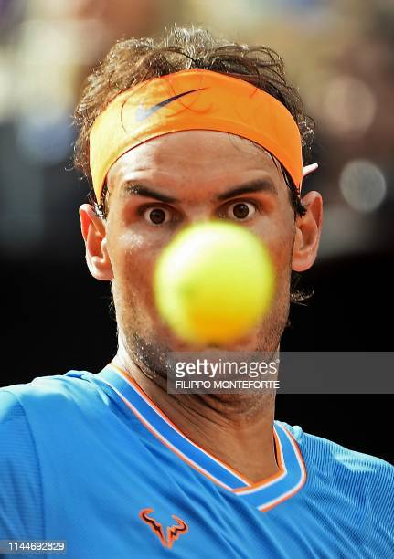 Rafael Nadal of Spain eyes the ball as he return to Greece's Stefanos Tsitsipas during their ATP Masters tournament semi final tennis match at the...