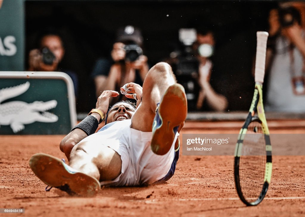 Rafael Nadal of Spain falls backwards after victory during his match against Stan Wawrinka of Switzerland during the Men's Singles Final, on day fifthteen at Roland Garros on June 11, 2017 in Paris, France.