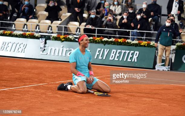 Rafael Nadal of Spain falls to his knees as he celebrates after defeating Novak Djokovic of Serbia during the men's singles final on day fifteen of...