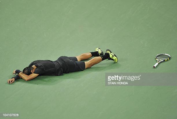 Rafael Nadal of Spain falls to the court as he celebrates his 64 57 64 62 win over Novak Djokovic of Serbia in the Men's Finals at the US Open 2010...