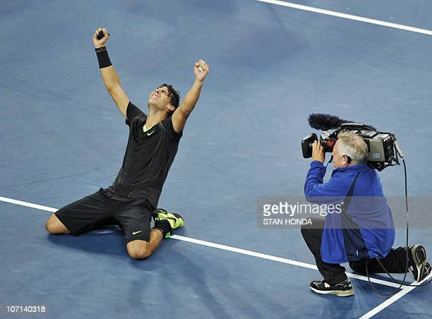 Rafael Nadal of Spain falls to the court as he celebrates his 6-4, 5-7, 6-4, 6-2 win over Novak Djokovic of Serbia in the Men's Finals at the US Open...