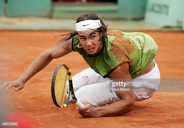 Rafael Nadal of Spain falls to the floor against Mariano Puerta of Argentina during the Mens Final match on the fourteenth day of the French Open at...