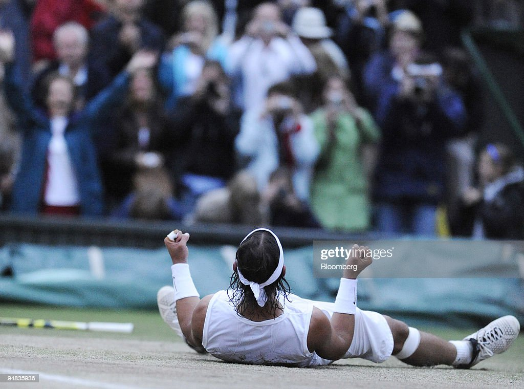 Rafael Nadal of Spain falls to the ground after his victory : News Photo