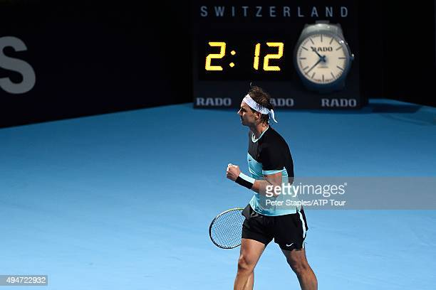 Rafael Nadal of Spain fist pumps his team after winning match point against Grigor Dimitrov of Bulgaria at the Swiss Indoors Basel at St Jakobshalle...