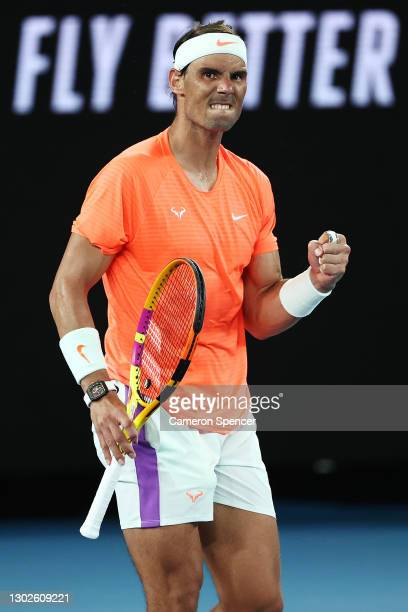 Rafael Nadal of Spain gestures during his Men's Singles Quarterfinals match against Stefanos Tsitsipas of Greece during day 10 of the 2021 Australian...