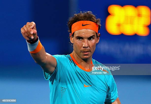 Rafael Nadal of Spain gestures during the playoff match for third place of the Mubadala World Tennis Championship at Zayed Sport City on January 3...
