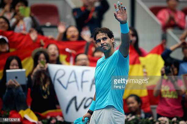 Rafael Nadal of Spain gestures following his win against Tomas Berdych of the Czech Republic during their men's semifinal match on day eight of the...