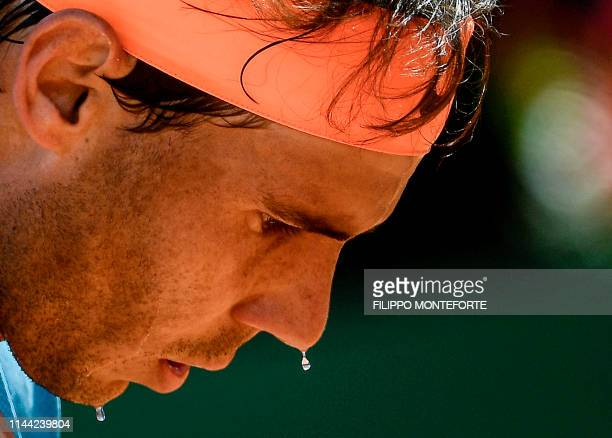 TOPSHOT Rafael Nadal of Spain gets ready to serve to Spain's Fernando Verdasco during their ATP Masters tournament quarter final tennis match at the...