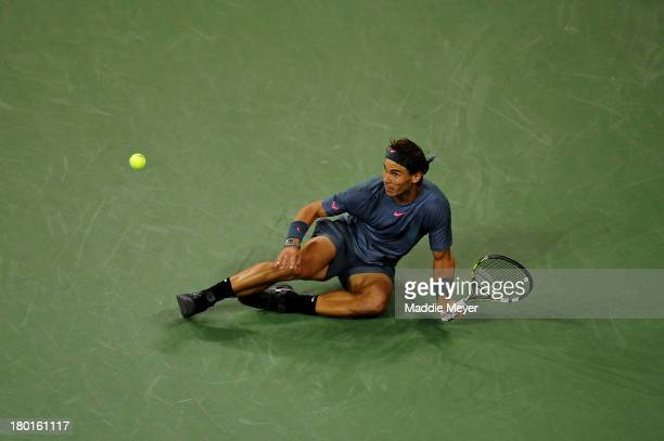 Rafael Nadal of Spain gets up after falling over during his men's singles final match against Novak Djokovic of Serbia on Day Fifteen of the 2013 US...