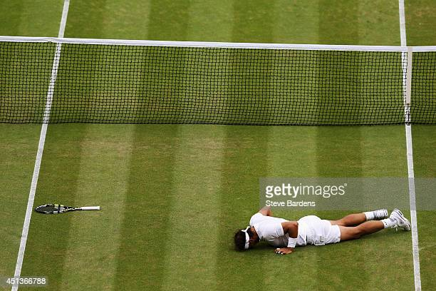 Rafael Nadal of Spain gets up after slipping over during his Gentlemen's Singles third round match against Mikhail Kukushkin of Kazakhstan on day six...