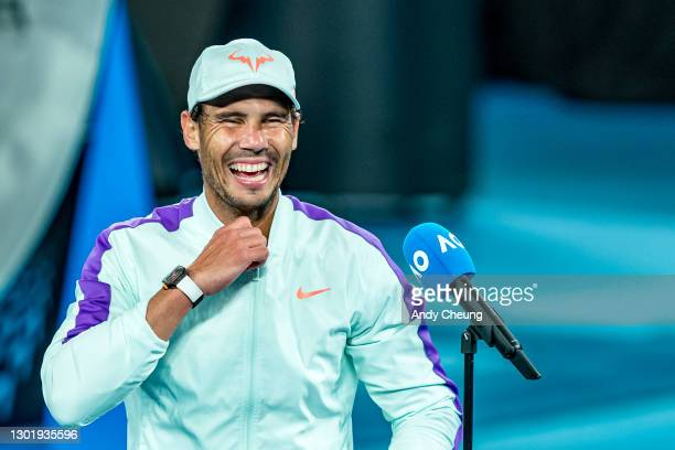 Rafael Nadal of Spain gives a court side interview after winning match point in his Men's Singles third round match against Cameron Norrie of Great...
