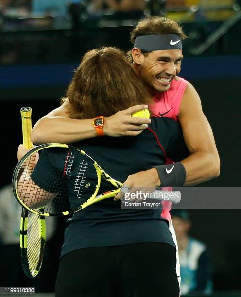 Rafael Nadal of Spain gives Deb a firefighter a hug after she played on court during the Rally for Relief Bushfire Appeal event at Rod Laver Arena on...