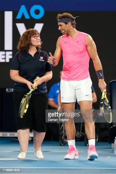 Rafael Nadal of Spain gives Deb a firefighter some advice during the Rally for Relief Bushfire Appeal event at Rod Laver Arena on January 15 2020 in...