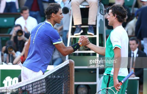 Rafael Nadal of Spain greets Dominic Thiem of Austria following his semifinal's victory during day 13 of the 2017 French Open second Grand Slam of...