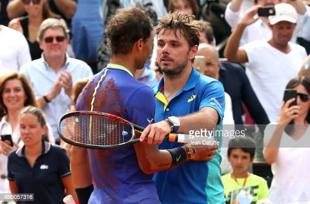 Rafael Nadal of Spain greets Stan Wawrinka of Switzerland after winning his 10th title at the French Open following the men's final on day 15 of the...