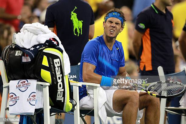Rafael Nadal of Spain grimaces against Novak Djokovic of Serbia during the Men's Final on Day Fifteen of the 2011 US Open at the USTA Billie Jean...