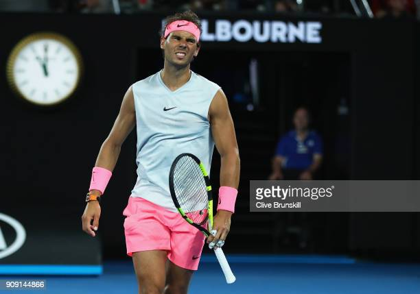 Rafael Nadal of Spain grimaces in discomfort in his quarterfinal match against Marin Cilic of Croatia on day nine of the 2018 Australian Open at...