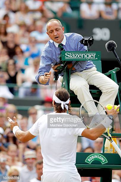 Rafael Nadal of Spain has a discussion with the Chair Umpire during his Quarter Final match against Robin Soderling of Sweden on Day Nine of the...