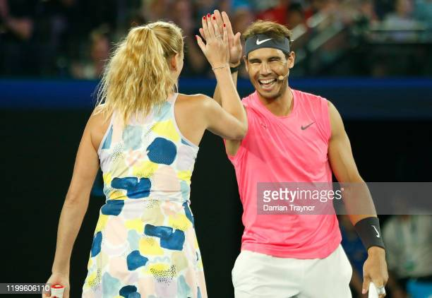 Rafael Nadal of Spain high fives Petra Kvitova of the Czech Republic during the Rally for Relief Bushfire Appeal event at Rod Laver Arena on January...