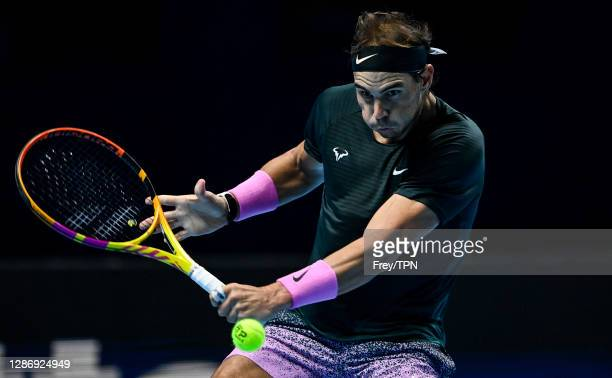 Rafael Nadal of Spain hits a backhand against Daniil Medvedev of Russia during Day 7 of the Nitto ATP World Tour Finals at The O2 Arena on November...