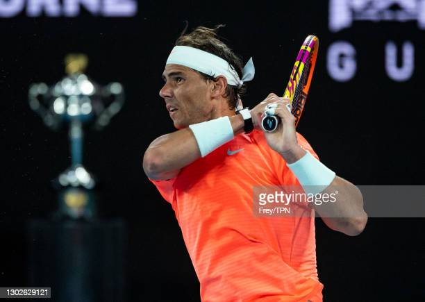 Rafael Nadal of Spain hits a backhand against Stefanos Tsitsipas of Greece during day 10 of the 2021 Australian Open at Melbourne Park on February...