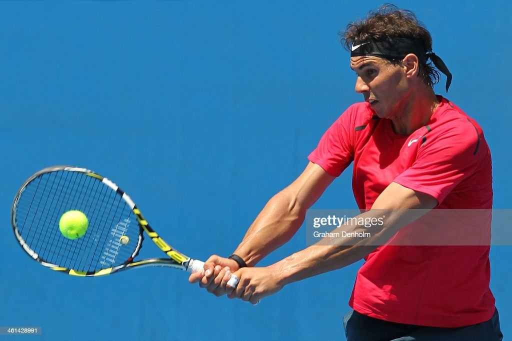 Rafael Nadal of Spain hits a backhand during a practice session ahead of the 2014 Australian Open at Melbourne Park on January 9, 2014 in Melbourne, Australia.