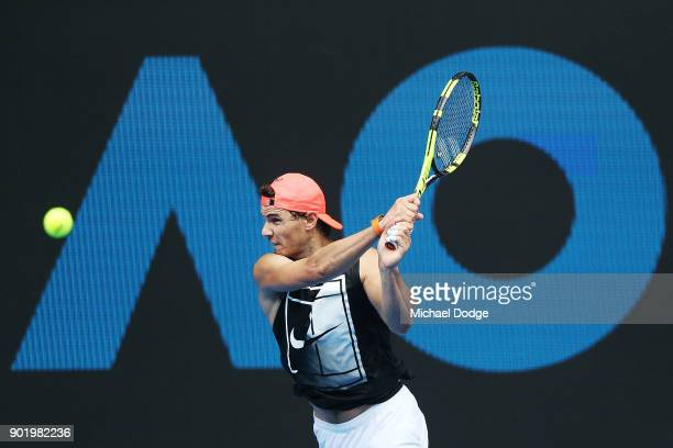 Rafael Nadal of Spain hits a backhand during a practice session ahead of the 2018 Australian Open at Melbourne Park on January 7 2018 in Melbourne...