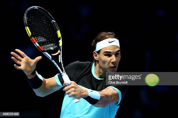 Rafael Nadal of Spain hits a backhand during the men's singles match against David Ferrer of Spain on day six of the Barclays ATP World Tour Finals...