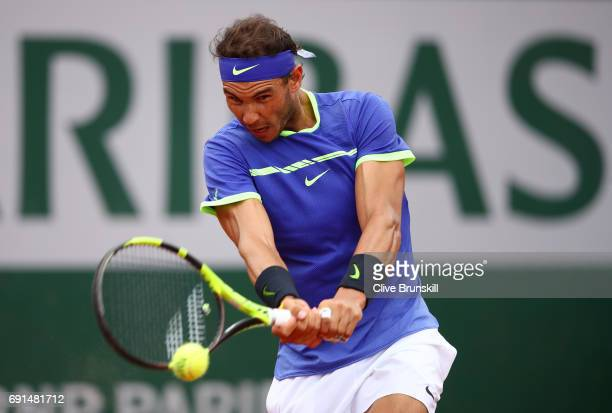 Rafael Nadal of Spain hits a backhand during the men's singles third round match against Nikoloz Basilashvili of Georgia on day six of the 2017...