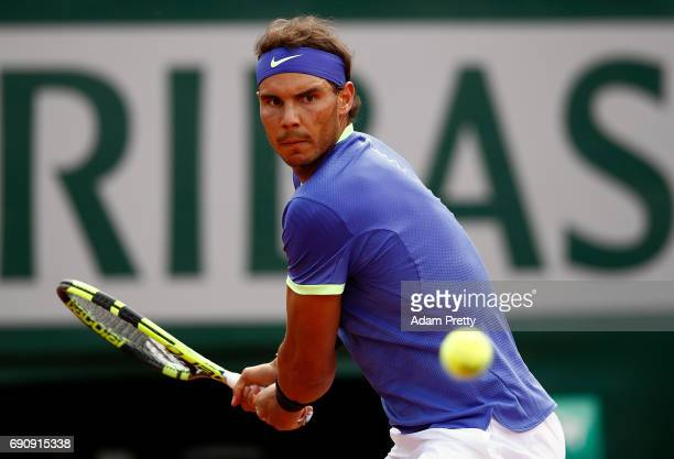 Rafael Nadal of Spain hits a backhand during the second roun match against Robin Haase of The Netherlands on day four of the 2017 French Open at...