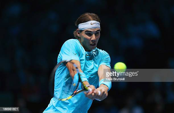 Rafael Nadal of Spain hits a backhand in his men's singles match against David Ferrer of Spain during day two of the Barclays ATP World Tour Finals...